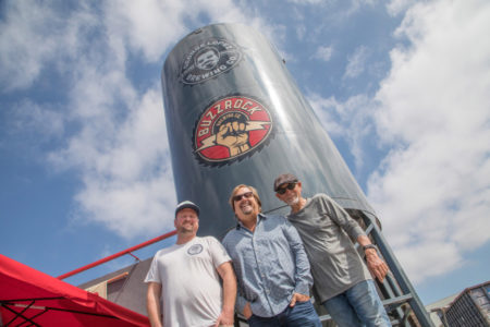 Head Brewer Justinian Caire, primary owner Michael Zislis and Dave Furano in the front of the breweries silo